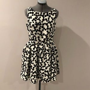 Fit and flare cream dress with polka dots.